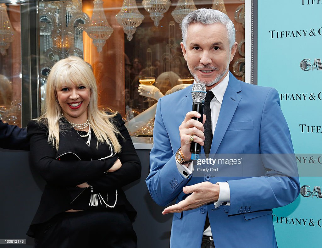 Writer/director/producer Baz Luhrmann (R) speaks as two-time Oscar-winning costume and production designer, Catherine Martin looks on during the Great Gatsby Window Unveiling at Tiffany & Co. on April 17, 2013 in New York City.