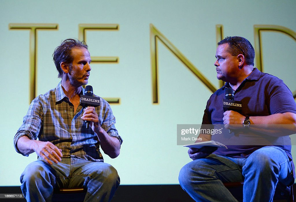 Writer/director/producer <a gi-track='captionPersonalityLinkClicked' href=/galleries/search?phrase=Peter+Berg&family=editorial&specificpeople=221450 ng-click='$event.stopPropagation()'>Peter Berg</a> (L) of Universal Pictures and moderator Mike Fleming speak onstage during Deadline Hollywood's The Contenders on November 2, 2013 in Beverly Hills, California.