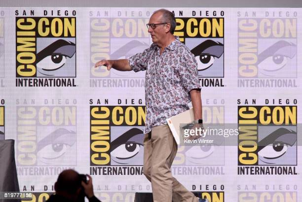 Writer/executive producer Dave Gibbons walks onstage at the 20th Century FOX panel during ComicCon International 2017 at San Diego Convention Center...