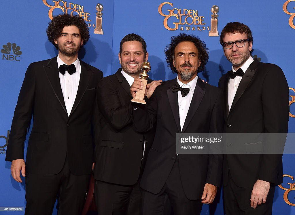 Writer/Producer Alexander Dinelaris, Writer/Associate Producer Armando Bo, Writer/Director/Producer Alejandro Gonzalez Inarritu and Writer/Associate Producer Nicolas Giacobone, winners of Best Screenplay Award for 'Birdman' pose in the press room during the 72nd Annual Golden Globe Awards at The Beverly Hilton Hotel on January 11, 2015 in Beverly Hills, California.