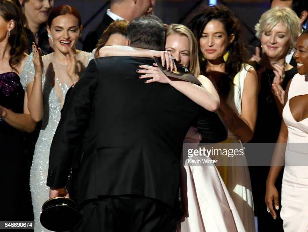 Writer/producer Bruce Miller and actor Elisabeth Moss with cast and crew of 'The Handmaid's Tale' accept the Outstanding Drama Series award onstage...