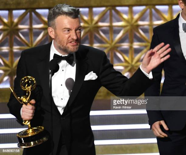 Writer/producer Charlie Brooker accepts Outstanding Television Movie for 'Black Mirror' onstage during the 69th Annual Primetime Emmy Awards at...