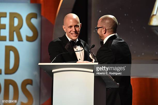 Writer/producer Damon Lindelof presents the Valentine Davies Award to honoree John August onstage during the 2016 Writers Guild Awards at the Hyatt...