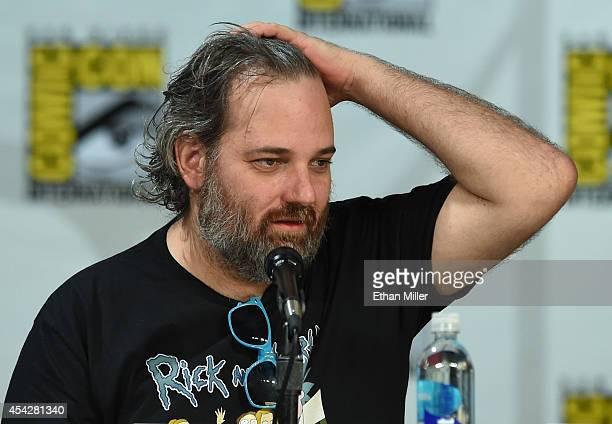 Writer/producer Dan Harmon fixes his hair as he looks at a monitor showing the 'Community' panel during ComicCon International 2014 at the San Diego...