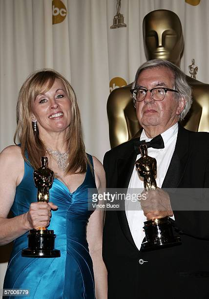 Writer/producer Diana Ossana and writer Larry McMurtry pose backstage with their Oscar Statuettes for Best Writing Screenplay Based on Material...