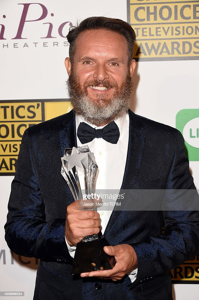 Writer/producer <a gi-track='captionPersonalityLinkClicked' href=/galleries/search?phrase=Mark+Burnett&family=editorial&specificpeople=204697 ng-click='$event.stopPropagation()'>Mark Burnett</a>, winner of Best Reality Series- Competition 'Shark Tank', poses in the press room during the 4th Annual Critics' Choice Television Awards at The Beverly Hilton Hotel on June 19, 2014 in Beverly Hills, California.