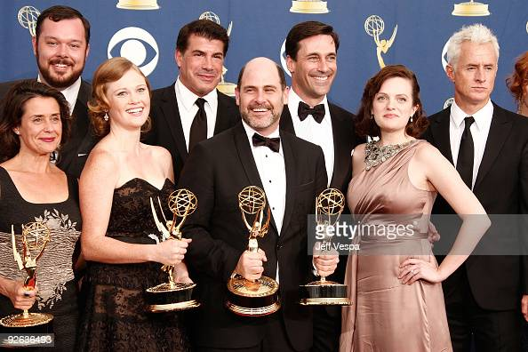 Writer/producer Matthew Weiner with the cast and crew of 'Mad Men' pose in the press room at the 61st Primetime Emmy Awards held at the Nokia Theatre...