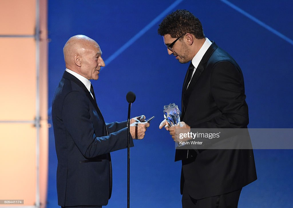 Writer-producer Sam Esmail (R) accepts the Best Drama Series award for 'Mr. Robot' from actor Sir Patrick Stewart onstage during the 21st Annual Critics' Choice Awards at Barker Hangar on January 17, 2016 in Santa Monica, California.