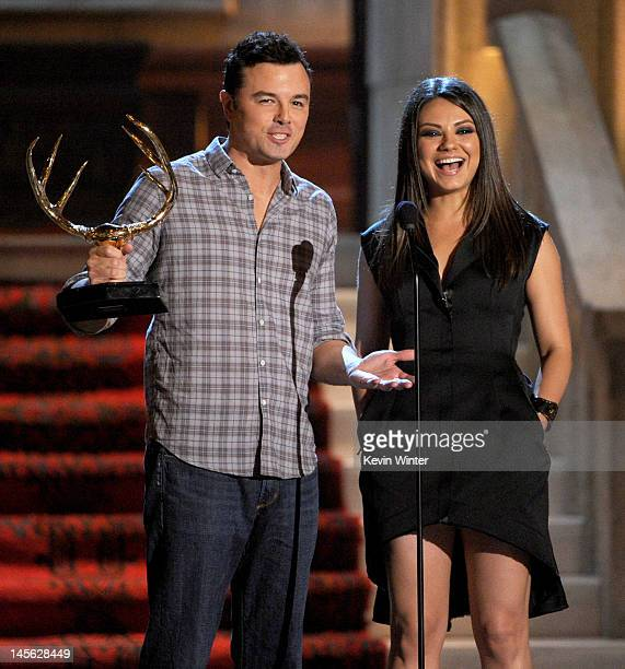 Writer/producer Seth MacFarlane and actress Mila Kunis present an award onstage during Spike TV's 6th Annual 'Guys Choice Awards' at Sony Pictures...