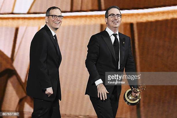 Writer/producer Tim Carvell and TV personality John Oliver accept Outstanding Variety Talk Series for 'Last Week Tonight with John Oliver' onstage...