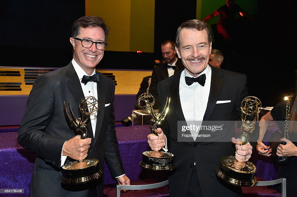 Writer/Producer/Host <a gi-track='captionPersonalityLinkClicked' href=/galleries/search?phrase=Stephen+Colbert&family=editorial&specificpeople=215133 ng-click='$event.stopPropagation()'>Stephen Colbert</a> (L), winner of the for Outstanding Variety Series Award for The Colbert Report (L) and actor <a gi-track='captionPersonalityLinkClicked' href=/galleries/search?phrase=Bryan+Cranston&family=editorial&specificpeople=217768 ng-click='$event.stopPropagation()'>Bryan Cranston</a>, winner of the Outstanding Lead Actor in a Drama Series Award and Outstanding Drama Series Award for Breaking Bad attends the 66th Annual Primetime Emmy Awards Governors Ball held at Los Angeles Convention Center on August 25, 2014 in Los Angeles, California.