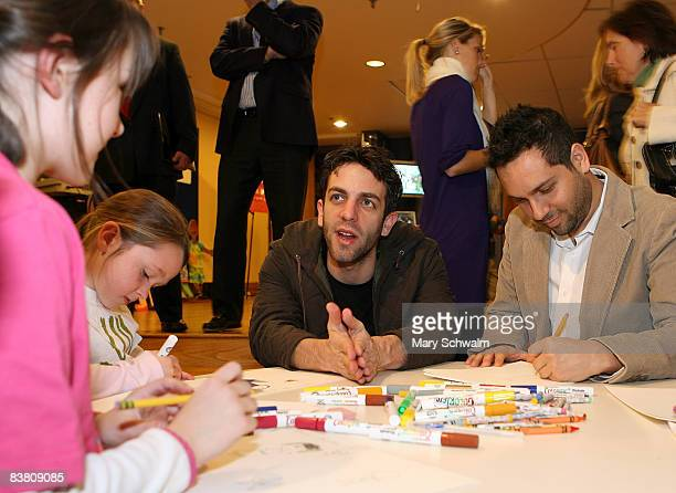 Writers and coexecutive producers of the NBC Comedy series 'The Office' BJ Novak and Lee Eisenberg work on drawings alongside children during the...