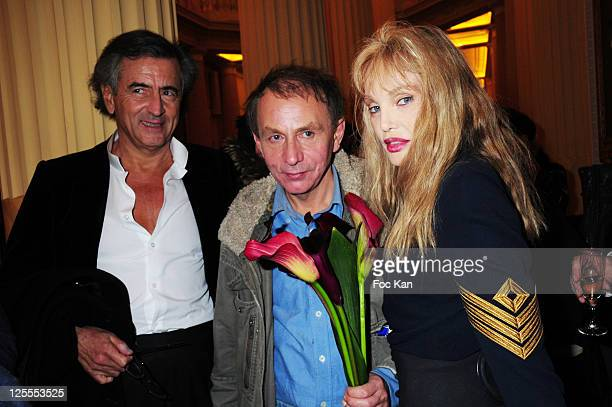 Writers Bernard Henri Levy Michel Houellebecq and actress Arielle Dombasle attend the Flammarion Celebrates Michel Houellebecq Goncourt Award at the...
