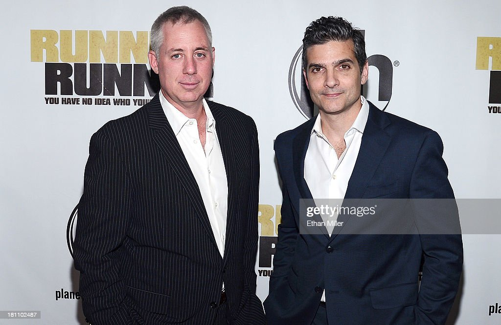 Writers Brian Koppelman (L) and David Levien arrive at the world premiere of Twentieth Century Fox and New Regency's film 'Runner Runner' at Planet Hollywood Resort & Casino on September 18, 2013 in Las Vegas, Nevada.