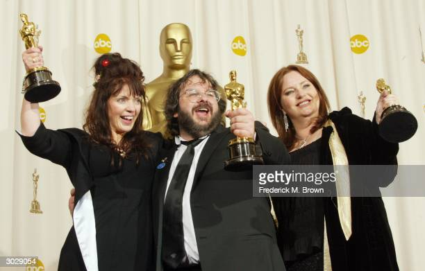Writers Fran Walsh Peter Jackson and Philippa Boyens pose with their Oscar for Best Adapted Screenplay for 'The Lord of the Rings The Return of the...
