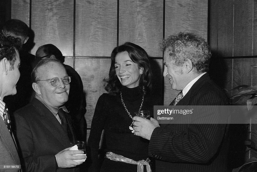 Writers get together at a cocktail party in New York December 19th. Truman Capote (L) and Norman Mailer (R) share the literary limelight with Princess Lee Radziwill, or rather, she shares it with them. The princess was the writer of the moment as the Ladies' Home Journal gave the party in her honor to mark publication, in the magazine, of her forthcoming book, Opening Chapters.