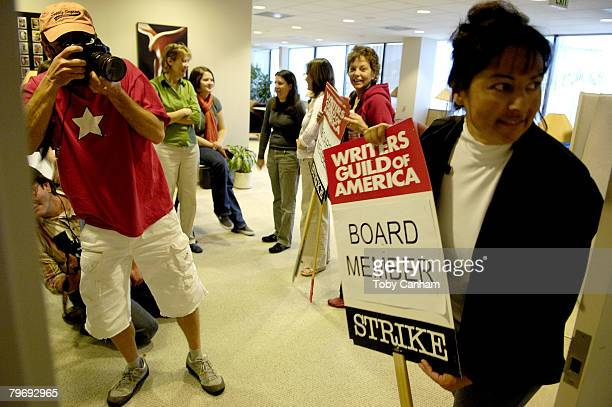 Writers Guild of America member Nancy Delos Santos looks in on the assembled media for the WGA press conference held at the WGAW Headquarters...