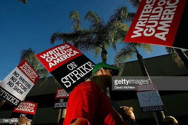 Writers Guild of America members and supporters picket in front of NBC studios as hope grows that a draft copy of a proposed deal with Hollywood...