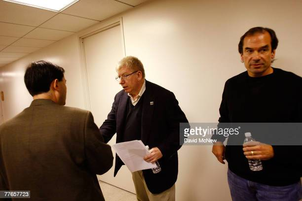 Writers Guild of America West President Patric Verrone Writers look on as Writers Guild of America East President Michael Winship and WGA Negotiating...