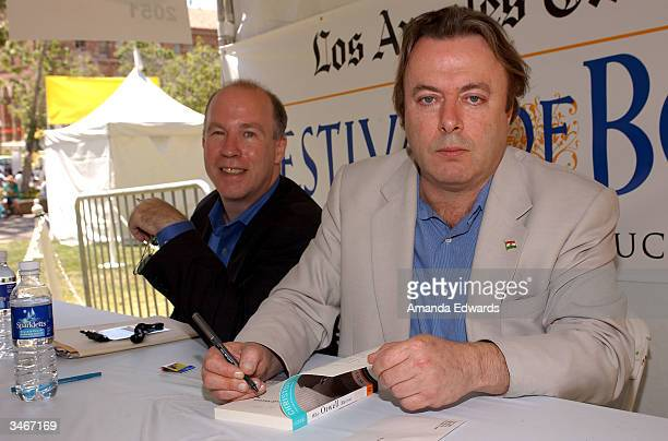 Writers Mark Danner and Christopher Hitchens sign copies of their books at the 9th Annual LA Times Festival of Books on April 25 2004 at UCLA in...