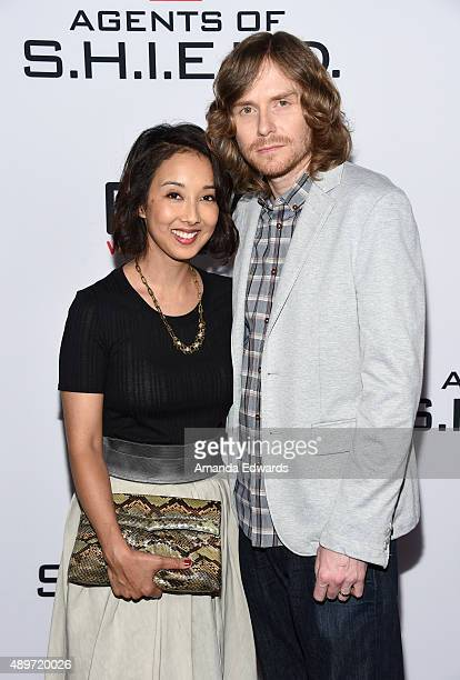 Writers Maurissa Tancharoen and Jed Whedon arrive at the premiere of Marvel's 'Agents Of SHIELD' at Pacific Theatres at The Grove on September 23...