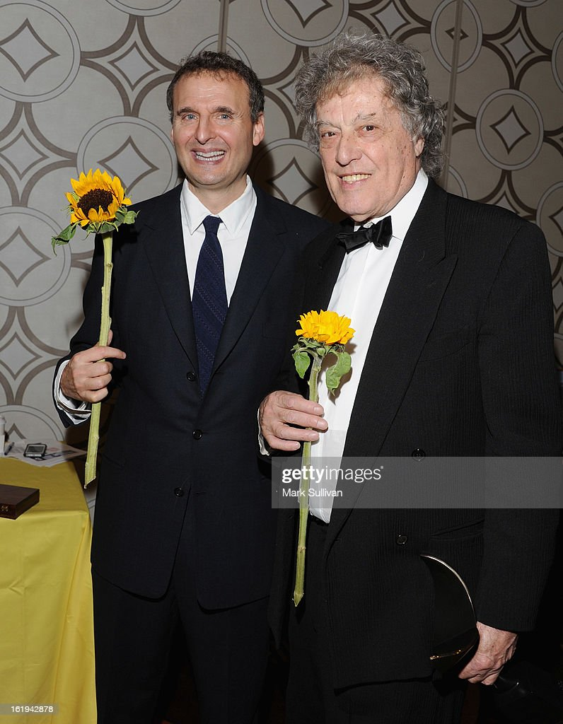 Writers Philip Rosenthal and <a gi-track='captionPersonalityLinkClicked' href=/galleries/search?phrase=Tom+Stoppard&family=editorial&specificpeople=241296 ng-click='$event.stopPropagation()'>Tom Stoppard</a> attend the 2013 Writers Guild Awards Backstage Creations Celebrity Retreat on February 17, 2013 in Los Angeles, California.