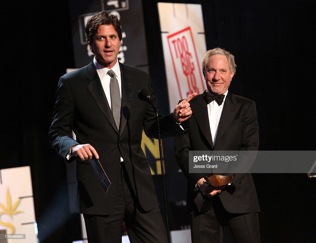 Writers Steven Levitan (L) and Jeffrey Richman accept the Outstanding Writing for a Comedy Series award onstage during the 2012 Writers Guild Awards at the Hollywood Palladium on February 19, 2012 in Los Angeles, California.