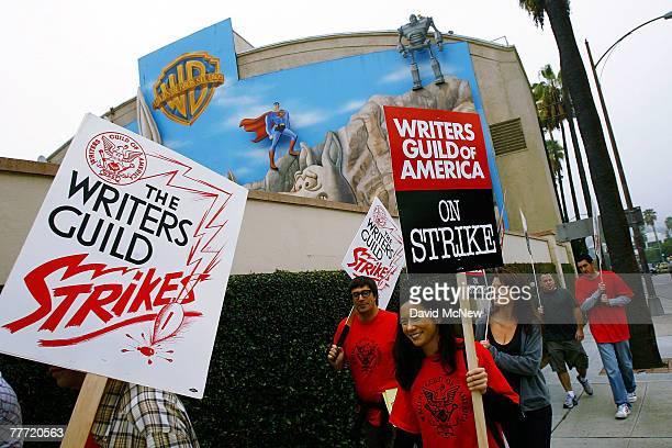 Writers walk up a picket line outside Warner Brothers Studios after contract talks between the Writers Guild of America and the Alliance of Motion...