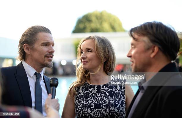 Writers/actors Ethan Hawke Julie Delpy and Director Richard Linklater are interviewed poolside at the 86th Academy Awards nominee luncheon at The...