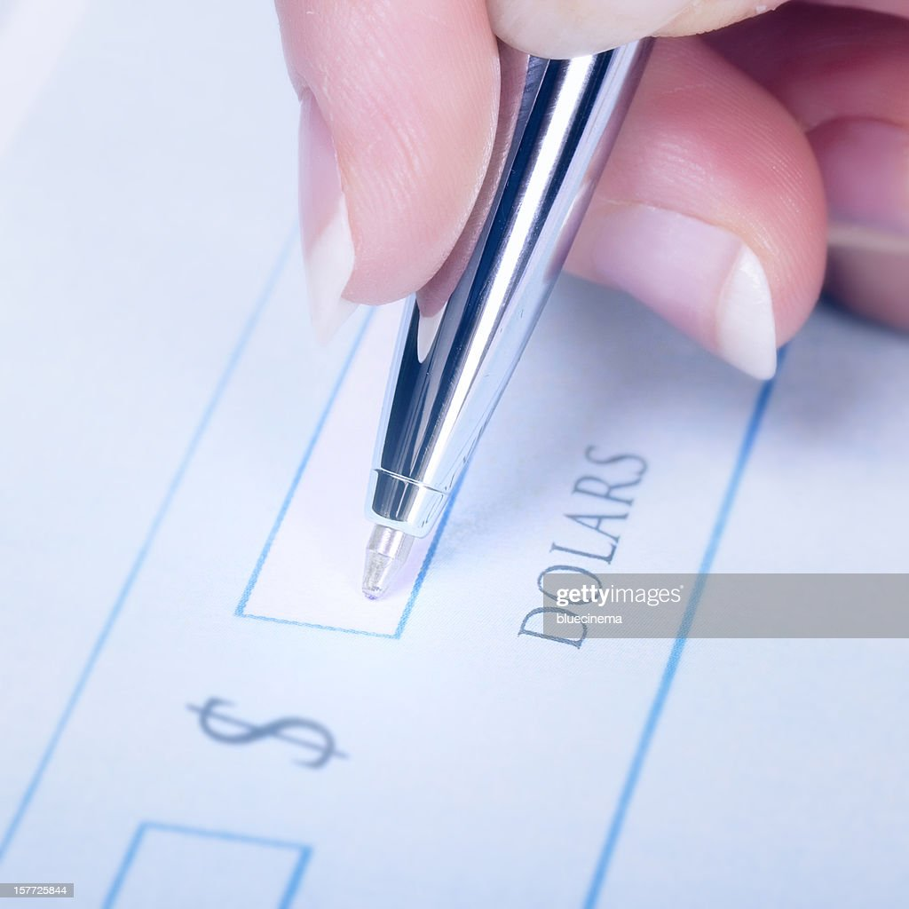 Writing a Check : Stock Photo