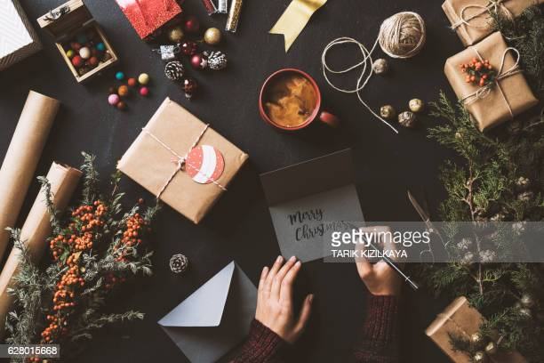 Writing Christmas cards, table top flat lay