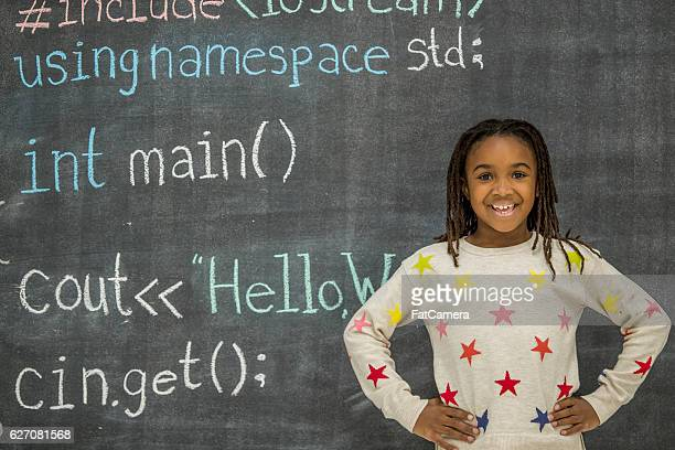 Writing Elements of Code on a Chalkboard