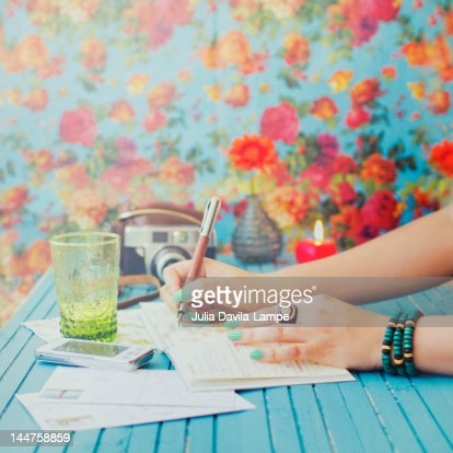 Writing her diary : Stock Photo