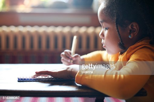 Writing her first book. : Stock Photo