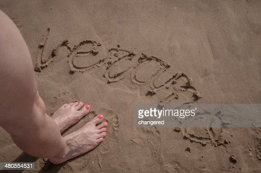 Writing in the sand : Stock Photo
