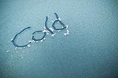 Writing on iced windscreen.