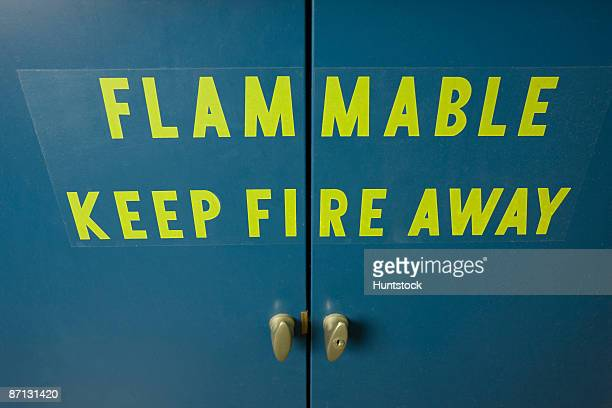 Writing on ventilated flammable cabinet door