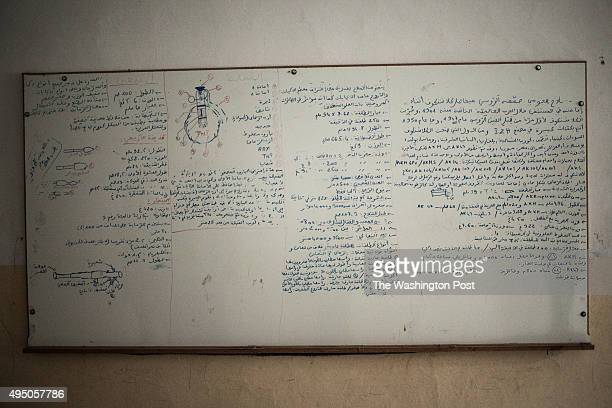 Writings on a white board found inside the church allegedly used by Islamic State militants as a prison and school