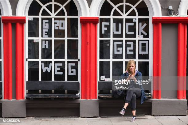 Writings on windows of a shop reading 'G20 go away' and 'Fuck G20' are pictured during the G20 Summit in Hamburg Germany on July 8 2017