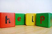 written help With wooden cubes