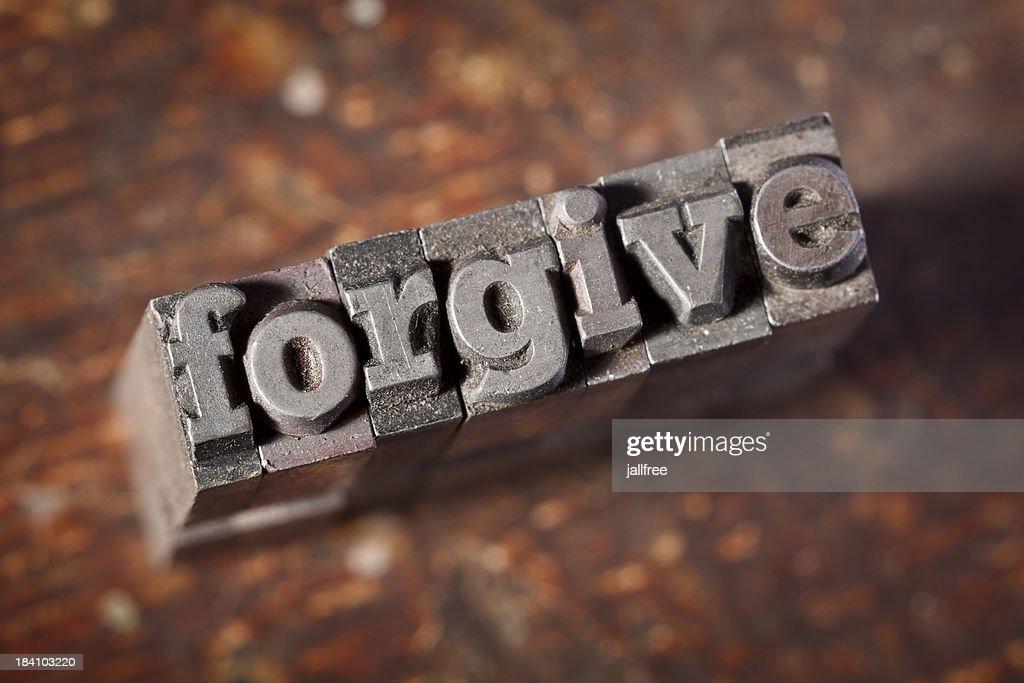 FORGIVE written in old metal letterpress on wood : Stock Photo