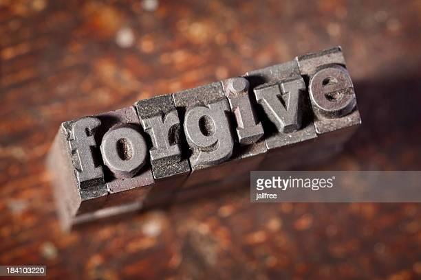 FORGIVE written in old metal letterpress on wood