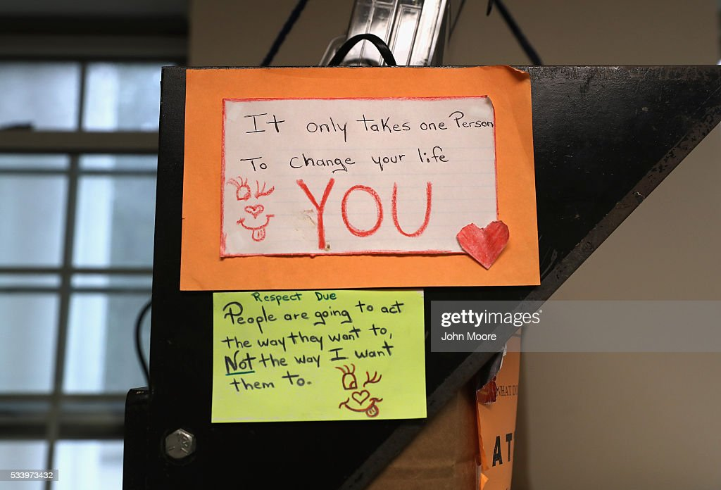 Written reminders hang on display over a female prisoner's bunk bed at the York Community Reintegration Center on May 24, 2016 in Niantic, Connecticut. The facility is part of the York Correctional Institution, which houses all of the states more than 1,000 female inmates. The unit is designed to prepare prisoners for successful reintegration into society after serving out their sentences. Criminal justice and prison reforms are taking hold with bi-partisan support nationwide in an effort to reduce prison populations, while saving taxpayer money. The state's criminal justice reforms are part of Connecticut Governor Dannel Malloy's 'Second Chance Society' legislation.
