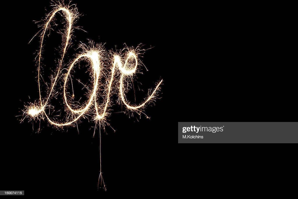LOVE written with sparkler : Stock Photo