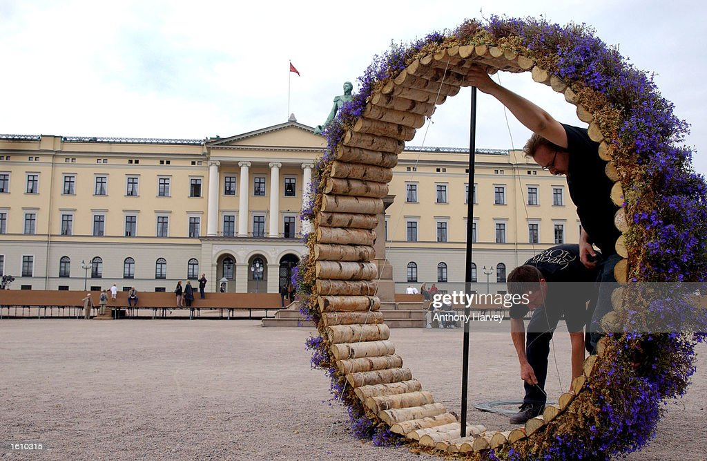 Wrkers install a flower and wood sculpture in front of the Oslo Royal Palace August 23 2001 in Oslo Norway where HRH Crown Prince Hakon and...