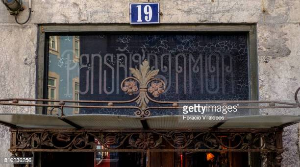 Wrought iron awning over the entrance on Rua do Alecrim 19 of 'Pensao Amor' on July 14 2017 in Lisbon Portugal 'Pensao Amor' used to be a five floors...