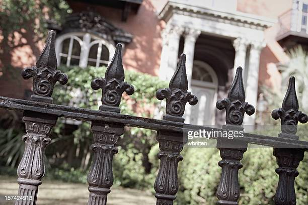 Wrought iron fence close-up outside a nice house