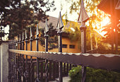 Nice wrought iron fence in afternoon backlight.
