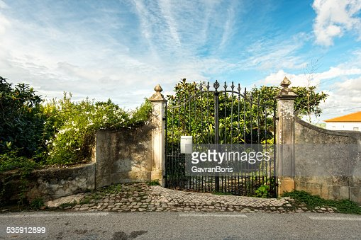 wrought iron gates near the house garden : Stock Photo