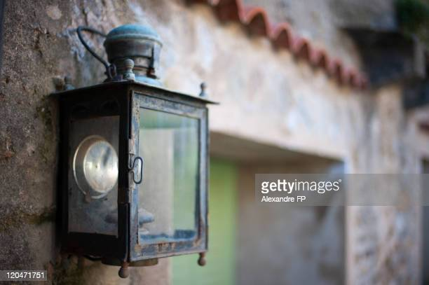 Wrought iron lantern on front wall in Provence